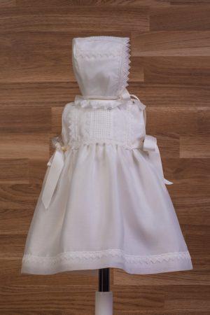 Vestido de niña en muselina con capota